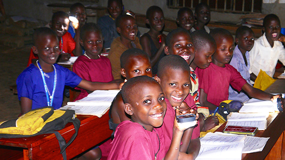 Children using solar lights in classroom
